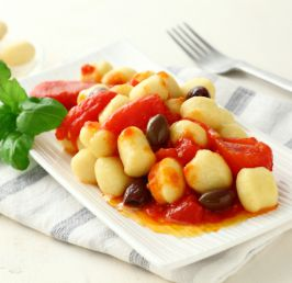 Chickpea gnocchi with peeled tomatoes and Taggiasca olives