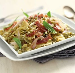 Bow-tie pasta with giant lentils, ham and sage